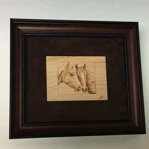 Pyography - mare and foal in frame