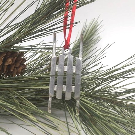 Jon Gibson pewter sled ornament available in Littleton NH